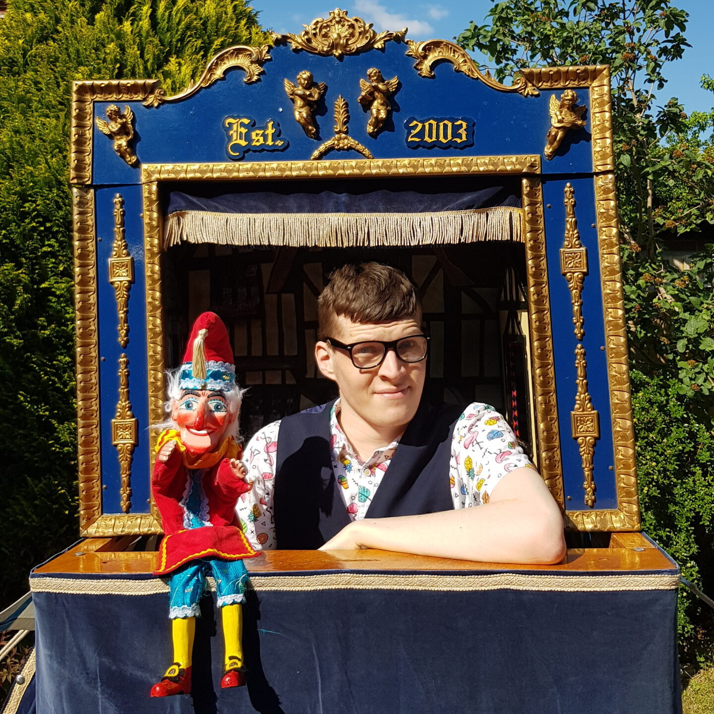 Mr Punch and Harvo inside the Punch and Judy Theatre