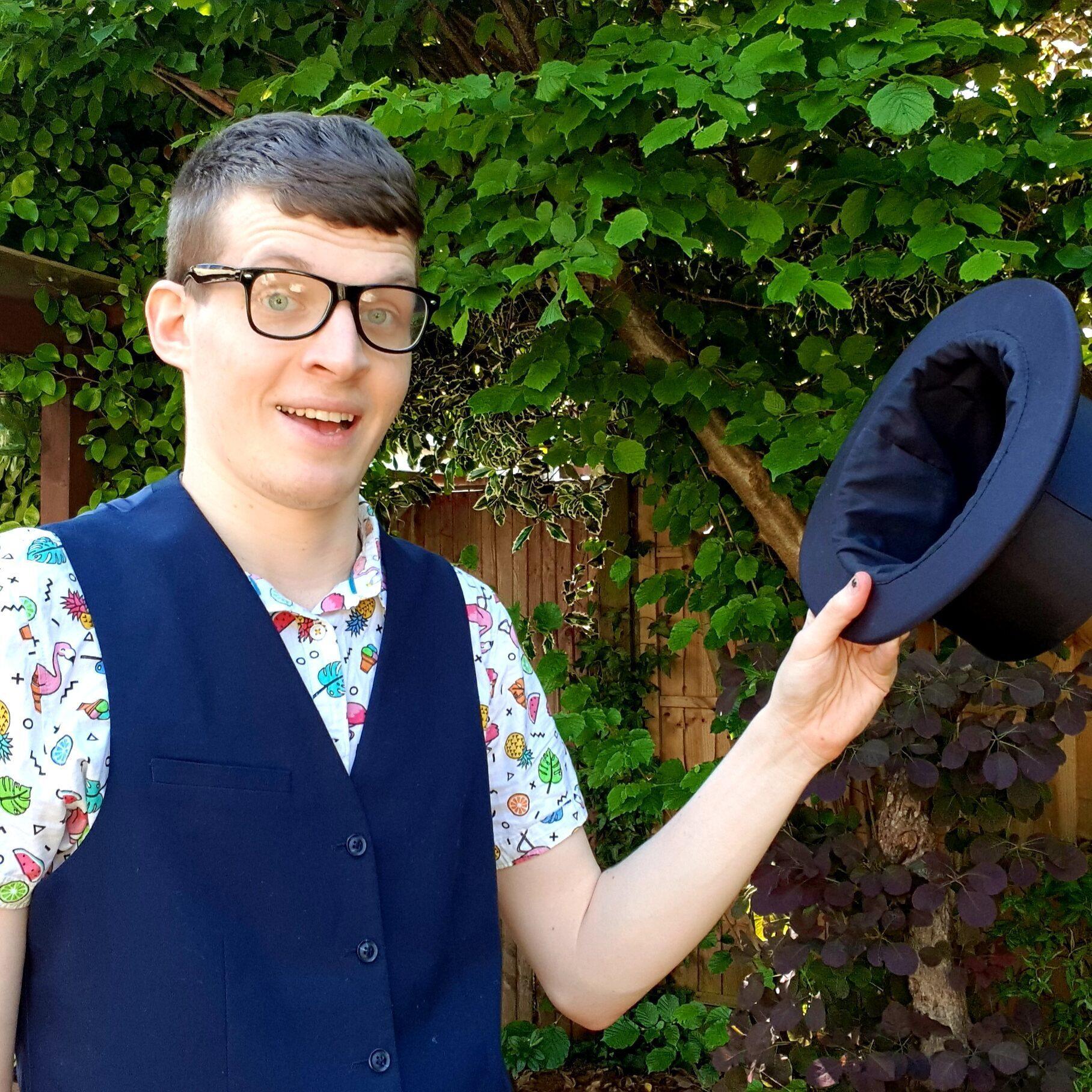 Harvo holding his hat