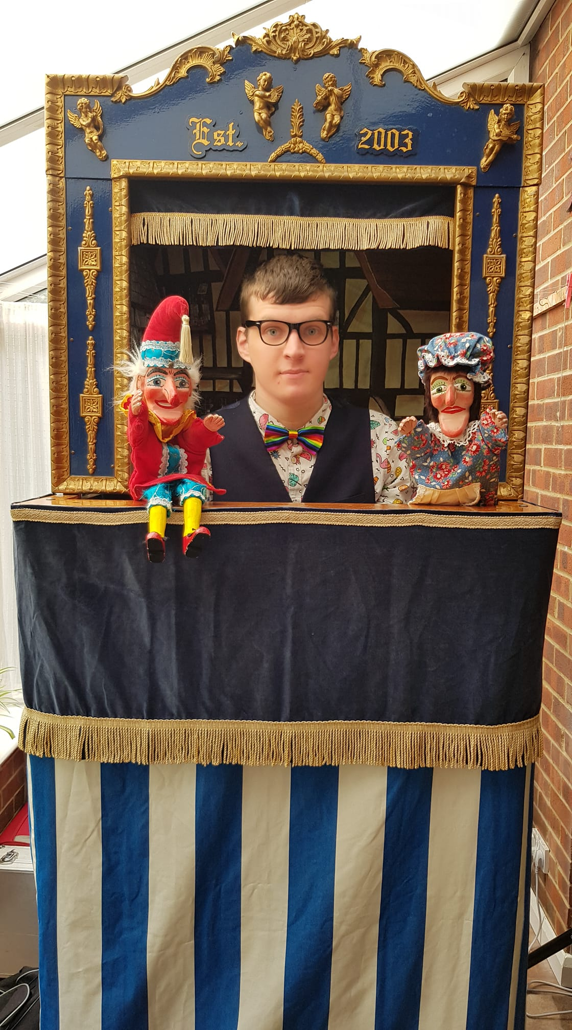 Professor Harvo with Mr Punch and Judy inside the Punch and Judy booth